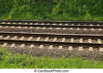 part of the railroad with an iron rail and concrete sleepers
