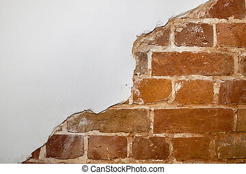 Part of the red brick wall of an old house with a figured pattern of white putty. Background, contrasting texture. A place for a label