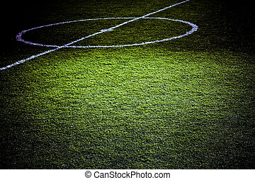 Part of the soccer terrain lighted for game highlights