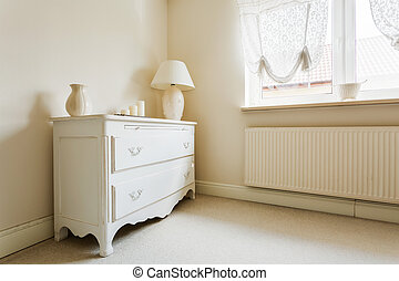 Part of wardrobe space - Photo of chest of drawers in...