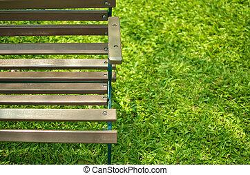 wood bench on grass field