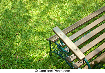 wood bench on grass