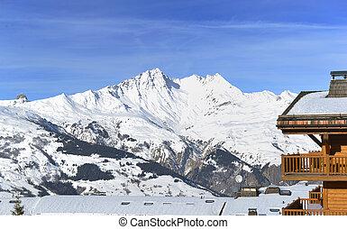 resort building in front of peak snowy mountain