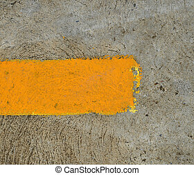 part of yellow arrow on the road