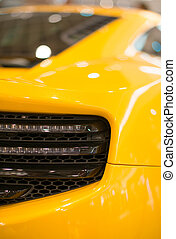 Part of yellow sports car model.