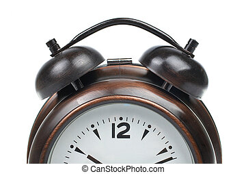 Partial view of alarm clock with bells on top isolated over white background