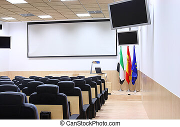 empty conference room with microphones and monitors displays flags of extremadura Spain and European Union