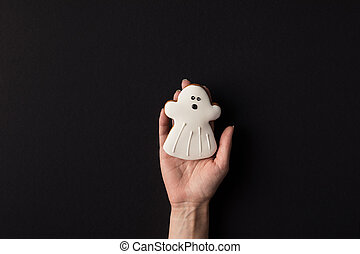 hand with halloween cookie