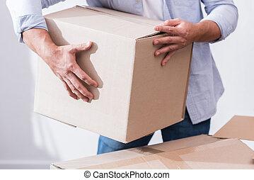 man holding cardboard box