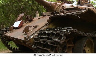 Partially-ruined T54 tank at Cambodia War Museum - A tilting...
