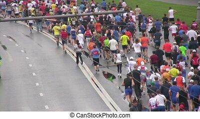 Participants of marathon run on XXX MOSCOW INTERNATIONAL...