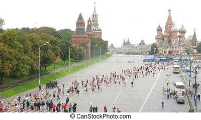 Participants of peace marathon run through Vasilevsky Spusk square