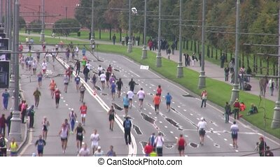 Participants run near Kremlin on XXX MOSCOW INTERNATIONAL PEACE MARATHON.