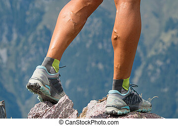 Particular athlete legs woman with muscles and veins