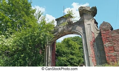 Partly ruined arched gate of old historic building - landmark of german prussian architecture in Kaliningrad, Russia (formerly Koenigsberg) at sunny spring day. Low angle view rendered in 4K