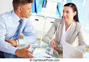 Partner talk - Successful business people talking about the...