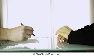 Partners signing contract. Close-up female client hands and male businessman hands with pan