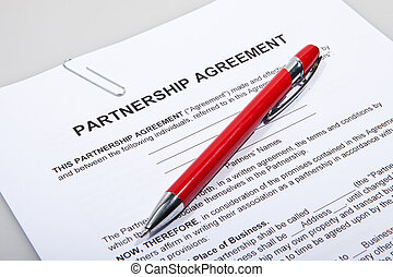 Partnership agreement forms with red pen