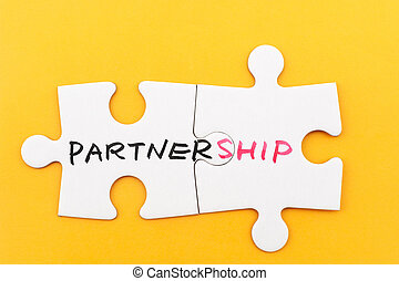 Partnership concept - Partnership word written on two pieces...