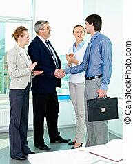Partnership - Photo of successful businessmen handshaking...