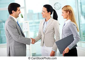 Partnership - Portrait of successful associates handshaking ...