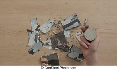 Parts of damaged battery cut magnet unrecognizable man hands top table view