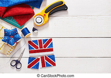 Parts of future pincushion viewing like union jack flag, sewing accessories