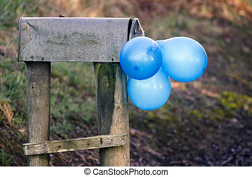 Party and celebration - Blue balloons on letter box, signal...