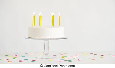 birthday cake with burning candles on table - party and...