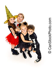 party costumes - Group of cute children wearing halloween...