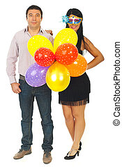 Party couple with balloons