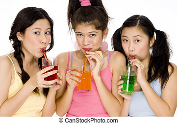 Party Drinks - Three cute asian women drinking colorful...