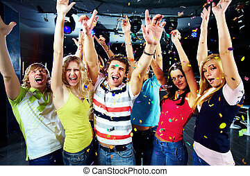 Party excitement - Photo of excited teenagers raising their...