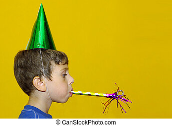 Party Favors - Young Boy Blowing a Party Favor and Wearing a...