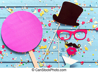 Party fun with photo booth accessories arranged as a gent in...
