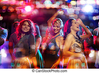 happy friends dancing in club with holidays lights - party,...