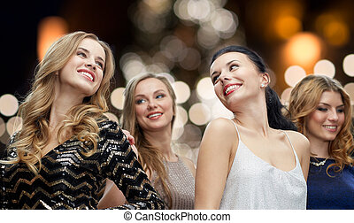 happy young women dancing over night lights - party,...