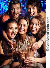 Party in full swing - Vertical shot of girls having fun at...