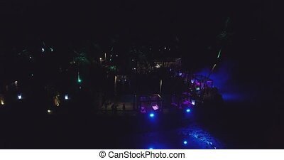 Party on club in Goa, India. Aerial view. Night