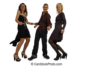 Party people - Full body view of two women and a man in chic...
