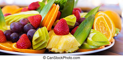 Party plate with fresh fruit cuts on a table