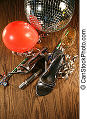 Party shoes on floor with champagne glass