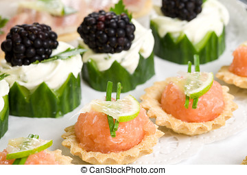 Party snacks - Plate full of delicious party snacks with...