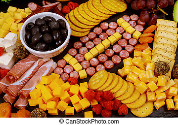 Party tray with charcuterie appetizer for Super Bowl fan.