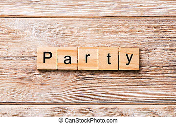 PARTY word written on wood block. PARTY text on wooden table for your desing, concept