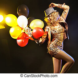 Partying girl with a bunch of balloons