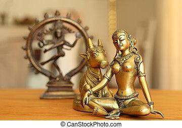 Parvati and a hokey kow - Goddess Parvati contemplates and...