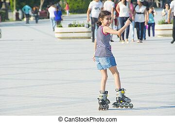 paseos, niña, parque, pcteres de ruedas