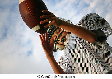 Pass Interception - A teenager holding a football ready to ...