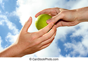 A hand passing on an apple to another hand